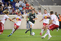 Eric Alexander (17) of the Portland Timbers draws a crowd of New York Red Bulls . The New York Red Bulls defeated the Portland Timbers 2-0 during a Major League Soccer (MLS) match at Red Bull Arena in Harrison, NJ, on September 24, 2011.