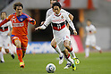 (L to R) Gotoku Sakai (Albirex), Keiji Tamada (Grampus), DECEMBER 3, 2011 - Football / Soccer : 2011 J.LEAGUE Division 1 final sec between Niigata Albirex 0-1 Nagoya Grampus at Niigata bigswan stadium in Niigata, Japan. (Photo by Yusuke Nakanishi/AFLO SPORT) [1090]