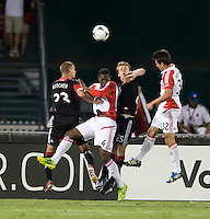 Perry Kitchen (23) and Jared Jeffrey (25) of D.C. United try to clear the ball away from Andrew Wiedeman (32) and Doneil Henry (4) of Toronto FC during a game at RFK Stadium in Washington, DC.  D.C. United tied Toronto FC, 1-1.