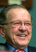 Washington, DC - January 5, 2005 -- United States Senator Ted Stevens (Republican of Alaska), Chairman, United States Senate Committee on Commerce, Science, and Transportation smiles as he listens to the testimony of  United States Secretary of Commerce-designate Carlos Gutierrez in Washington, D.C. on January 5, 2005. The Committee is considering Mr. Gutierrez' nomination as Secretary of Commerce to replace Don Evans.  Senator Stevens is also the President Pro-Tempore of the United States Senate which puts him third in the line of succession to the President of the United States..Credit: Ron Sachs / CNP