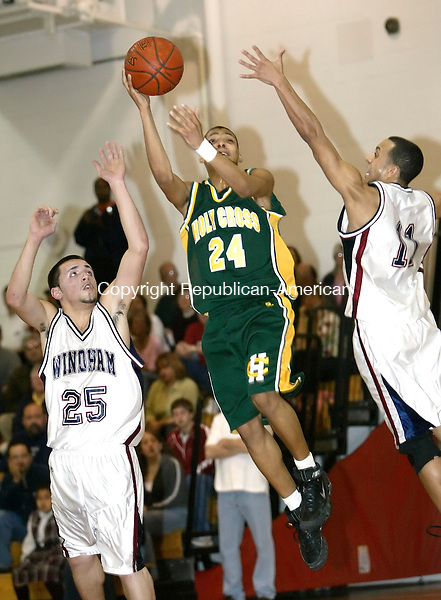 MANCHESTER, CT. 10 MARCH 2006- 031006BZ04- Holy Cross High's Jerome Mitchell (24) goes up against Windham Angel Beltran (25) and Christian Leon (11)<br /> during the quarterfinals of Divison II State Tournament Friday night.<br /> Jamison C. Bazinet Republican-American