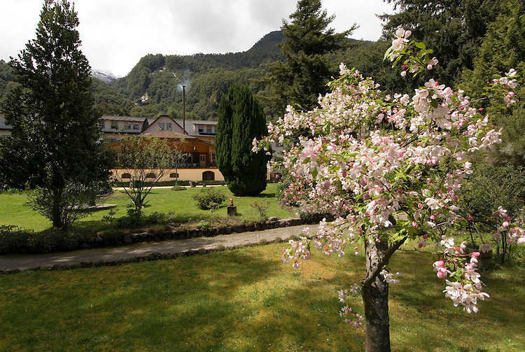 Chile, Lake Country: Flowering spring scene at Hotel Peulla in Peulla...Photo #: ch659-33447..Photo copyright Lee Foster www.fostertravel.com, lee@fostertravel.com, 510-549-2202.