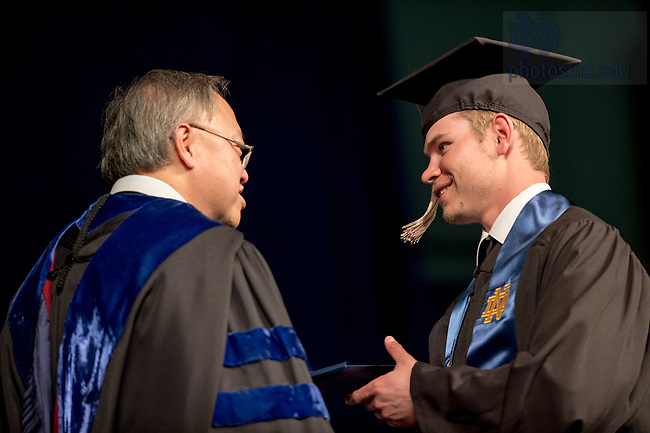 May 21, 2017; Former baseball player Kyle Fiala receives his diploma from Dean Roger Huang during the Mendoza College of Business undergraduate Commencement ceremony, 2017. (Photo by Matt Cashore/University of Notre Dame)
