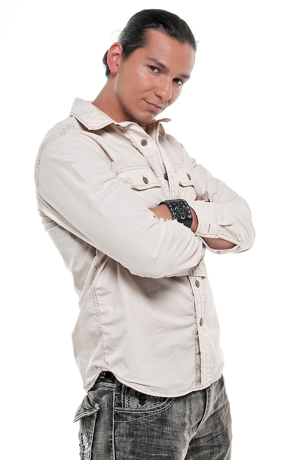 Young latin model very handsome looking at camera with casual clothes.