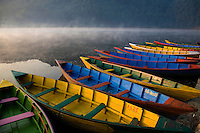 Fewa Lake Rowboats Phewa Tal or Lake Fewa is the second largest lake in Nepal.  This large lake is adjacent to the town of Pokhara, a popular trekkers hangout.  On a clear day, majestic views of the Annapurna Range of the Himalayas reflects on the lake.  The best way to take in Fewa Lake is by rowboat.