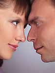 Closeup portrait of a man and a woman touching foreheads and looking at each other