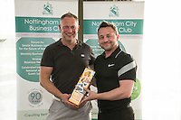 Nearest the 5th pin sponsor Turner & Townsend's Mark Deakin with winner Paul Lewis