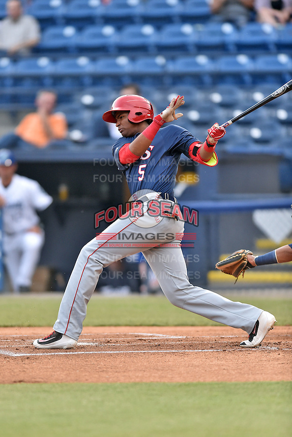 Hagerstown Suns third baseman Kelvin Gutierrez (5) swings at a pitch during a game against the Asheville Tourists at McCormick Field on April 27, 2016 in Asheville, North Carolina. The Tourists defeated the Suns 14-7. (Tony Farlow/Four Seam Images)