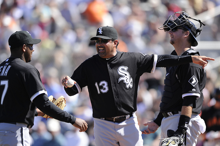 SCOTTSDALE, AZ - MARCH 09:  Manager Ozzie Guillen #13 gives the ball to Tony Pena #57 of the Chicago White Sox during a pitching change against the San Francisco Giants on March 09, 2011 at Scottsdale Stadium in Scottsdale, Arizona. The Giants defeated the White Sox 4-2.  (Photo by Ron Vesely)
