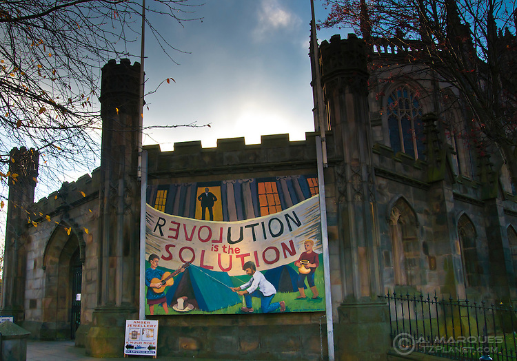 "A banner on a church on Princes Street, Edinburgh, Scotland, supporting the Occupy Edinburgh movement on nearby St Andrew's Square. Banner reads ""Revolution is the Solution"""