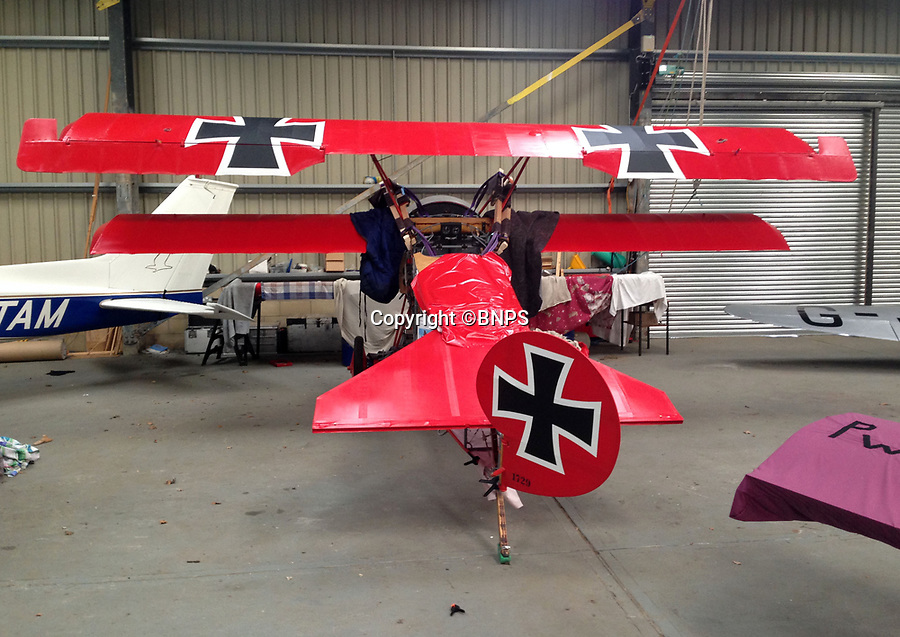 BNPS.co.uk (01202 558833)<br /> Pic: PhilYeomans/BNPS<br /> <br /> Two wings are fitted.<br /> <br /> Dreaded Red Baron to fly again...WW1 Ace's feared 'Fokker Dreidecker' to finally fly over Britain.<br /> <br /> A German GP based in Norfolk has spent 8 years building a Fokker triplane in his garage as a tribute to infamous WW1 Ace Manfred von Ricthofen, who terrorised the skies over the Western front during the first war.<br /> <br /> Dr Peter Brueggemann, 52, will fulfil his childhood dream and emulate the notorious German fighter pilot when the Dreidecker Dr.1 fighter finally achieves lift-off this summer.<br /> <br /> Dr Brueggemann has even acquired the title Baron from the independent territory of Sealand so he can take to the skies as Baron Peter von Brueggemann in homage to his idol.<br /> <br /> The GP at the Holt Medical Practice in Norfolk hopes to be airborne in a few months once tests on the engine are completed at Felthorpe airfield near Norwich where he has devoted thousands of hours to the project.<br /> <br /> The father-of-two, who has lived in England with wife Sue for 20 years, has been taking flying lessons since his project began.