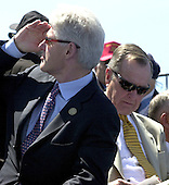 Washington, D.C. - May 29, 2004 -- Former United States President Bill Clinton, left and former United States President George H.W. Bush at the dedication of the World War Two Memorial in Washington, D.C. on May 29, 2004..Credit: Ron Sachs / CNP