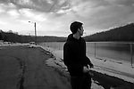 Christian Berardi, a sophomore nursing major at Waynesburg University, looks out at the Monongahela River from an empty parking lot amidst a bitter January wind in Crucible, Pa., a town over from Nemacolin.