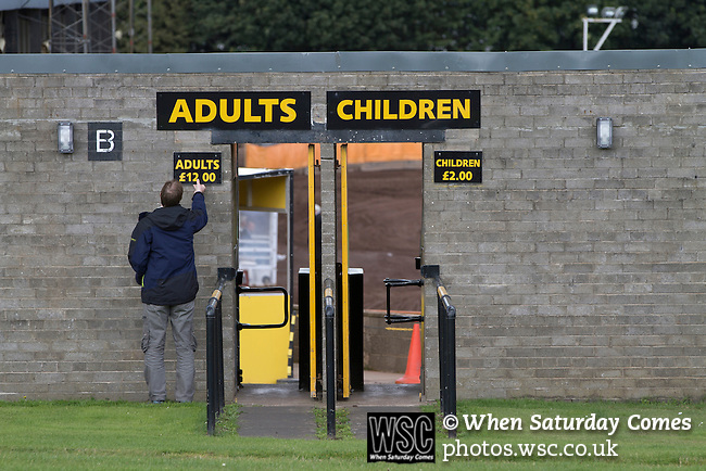 Berwick Rangers 5 East Stirlingshire 0, 23/08/2014. Shielfield Park, Scottish League Two. A groundsman putting up an admission price sign outside Shielfield Park, before the Scottish League Two fixture between Berwick Rangers and East Stirlingshire. The home club occupied a unique position in Scottish football as they are based in Berwick-upon-Tweed, which lies a few miles inside England. Berwick won the match by 5-0, watched by a crowd of 509. Photo by Colin McPherson.