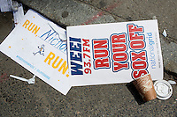 Discarded race placards and K-cards lay on the street near the site of the bombings in Boston, Mass., on April 16, 2013, the day after bombings at the Boston Marathon.