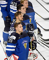 Finnish players and goalkeeper Harri Sateri (front) standing on the ice while the Finnish national anthem is being played after the Ice Hockey World Championship quarter-final match between the US and Final in the Lanxess Arena in Cologne, Germany, 18 May 2017. Photo: Monika Skolimowska/dpa /MediaPunch ***FOR USA ONLY***