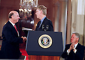 Doctor J. Craig Venter, President and Chief Scientific Officer, Celera Genomics Corporation, left, and Doctor Francis Collins, Director, National Institutes of Health (NIH), center, congratulate each other at the announcement of the completion of the first survey of the entire Human Genome at the White House in Washington, DC on June 26, 2000. United States President Bill Clinton is seated at far right.<br /> Credit: Ron Sachs / CNP