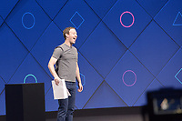 Mark Zuckerberg, founder of Facebook, speaks during the opening of the annual Facebook Developer Confernece F8 in San Jose, US, 18 April 2017. He uses a stack of paper to joke about the length of his manifesto on the role of Facebook in society he published two months ago. Photo: Andrej Sokolow/dpa /MediaPunch ***FOR USA ONLY***