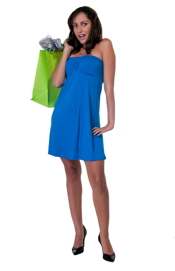 Young caucasian girl with shopping bags, very happy and with surprised gestureing..