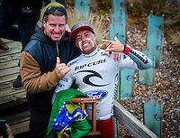 BELLS BEACH, Victoria/AUS (Tuesday, April 2, 2013) Mark Occhilupo (AUS) with de Souza. Occy was happy that Adriano had won because he is still the last goofy footer to win Bells- Adriano de Souza (BRA), 25, has claimed the 2013 Rip Curl Pro Bells Beach presented by Ford over ASP Dream Tour rookie .Nat Young (USA), 21, in clean three-to-five foot (1 - 1.5 metre) waves at Bells Beach today..Event No. 2 of 10 on the 2013 ASP World Championship Tour (WCT), the Rip Curl Pro Bells Beach culminated in dramatic fashion today with the young Brazilian claiming the first South American men's title in the event's storied 52-year history..De Souza's win today vaults the young South American ASP WCT No. 4 heading into the third event on tour in Brazil...Young, the rookie goofy-footer from California's Santa Cruz, posted a career-best result today, wowing spectators and competitors alike with his run to the Finals..Young's Runner-Up finish today pushes him to No. 5, tied with reigning ASP World Champion Joel Parkinson (AUS), 31, on the ASP WCT rankings..Taj Burrow (AUS), 34, perennial ASP World Title threat, continued his blistering Bells Beach run this morning against compatriot Kai Otton (AUS), 33, in the Quarterfinals before coming up short to Young in their Semifinal bout..Jordy Smith (ZAF), 25, was one of the form surfers at Bells Beach throughout the event window, consistently notching up high-scoring rides. The powerful South African's run was ended, however, in the Semifinals at the hands of De Souza. - Photo: joliphotos.com