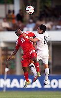 Esteban Rodriguez (8) of the United States goes up for a header with Aldair Paredes (11) of Panama during the group stage of the CONCACAF Men's Under 17 Championship at Jarrett Park in Montego Bay, Jamaica. The USA defeated Panama, 1-0.