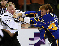 Peoria Rivermen right wing Eric Neilson, right, punches San Antonio Rampage right wing Francis Lessard during the first period of an AHL hockey game, Jan. 18, 2009, in San Antonio, Texas. San Antonio won 2 - 0. (Darren Abate/pressphotointl.com)