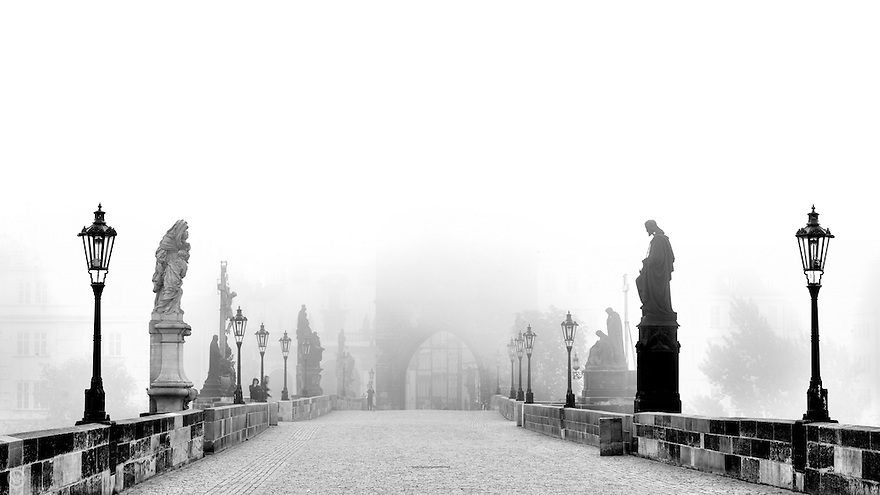 A foggy morning on the Charles Bridge in Prague, well before the tourists and hawkers set up.