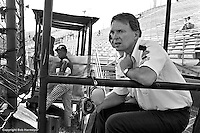 INDIANAPOLIS, IN: Dan Gurney monitors corner speeds from a position outside Turn 4 during practice for the Indianapolis 500 on May 29, 1977, at the Indianapolis Motor Speedway.
