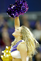 February 12, 2014:   Washington cheer member Hannah Tripp entertained fans during a timeout against Stanford.  Washington defeated Stanford 64-60 at Alaska Airlines Arena in Seattle, Washington.