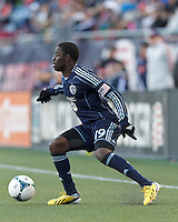 Sporting Kansas City substitute midfielder Peterson Joseph (19) controls the ball.  In a Major League Soccer (MLS) match, Sporting Kansas City (blue) tied the New England Revolution (white), 0-0, at Gillette Stadium on March 23, 2013.
