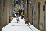 A street in Madaba, a sprawling Palestinian refugee camp in Jordan that has grown in recent years with the arrival of refugees from war-torn Syria. The  Department of Service for Palestinian Refugees of the Middle East Council of Churches, a member of the ACT Alliance, provides a variety of services here, including medical care.