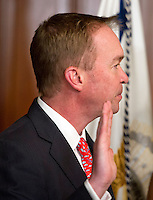 Former United States Representative Mick Mulvaney (Republican of South Carolina) takes the oath of office to be Director of the Office of Management and Budget (OMB) in the Vice President's Ceremonial Office at the White House in Washington, DC on Thursday, February 16, 2017. <br /> Credit: Ron Sachs / Pool via CNP /MediaPunch