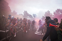 peloton led by former winner Alexander Kristoff (NOR/Katusha) up the smoke &amp; tifosi packed Capo Berta (38 km's before the finish) with later winner Michal Kwiatkowski (POL/SKY) emerging 2/3 rows down<br /> <br /> 108th Milano - Sanremo 2017
