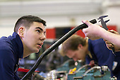 Students measuring a pipe with calipers, Motor Mechanics, Further Education College.