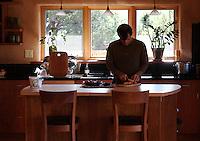 Tias Little prepares breakfast in the kitchen