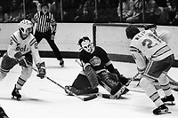 Seals Al MacAdam and Stan Weir attack Los angeles Kings goalie Gary Edwards. (1975 photo/Ron Riesterer)