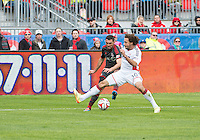 Toronto, Ontario - May 3, 2014: Toronto FC forward Gilberto #9 and New England Revolution defender Kevin Alston #30 in action during a game between the New England Revolution and Toronto FC at BMO Field.<br /> The New England Revolution won 2-1.