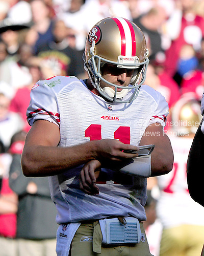 San Francisco 49ers quarterback Alex Smith (11) checks the play list on his wrist in second quarter action against the Washington Redskins at FedEx Field in Landover, Maryland on Sunday, November 6, 2011..Credit: Ron Sachs / CNP