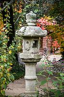Stone japanese lantern ornament in autumn at Marin Art & Garden Center