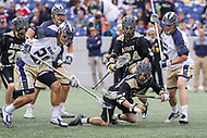 Annapolis, MD - April 15, 2017: Navy Midshipmen Steve Hincks (28) knocks the ball out of Army Black Knights Gunnar Miller (24) stick during game between Army vs Navy at  Navy-Marine Corps Memorial Stadium in Annapolis, MD.   (Photo by Elliott Brown/Media Images International)