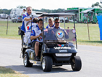 Sept. 2, 2013; Clermont, IN, USA: A golf cart full of crew members come to celebrate with NHRA pro mod driver Mike Janis after winning the US Nationals at Lucas Oil Raceway. Mandatory Credit: Mark J. Rebilas-