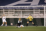3 November 2006: Wake Forest's Sarah Winslow (12) puts a shot on goal while falling over a Florida State defender. Florida State defeated Wake Forest 4-2 in penalty kicks after playing to a 0-0 draw after overtime at SAS Soccer Park in Cary, North Carolina in an Atlantic Coast Conference women's college soccer tournament semifinal game.