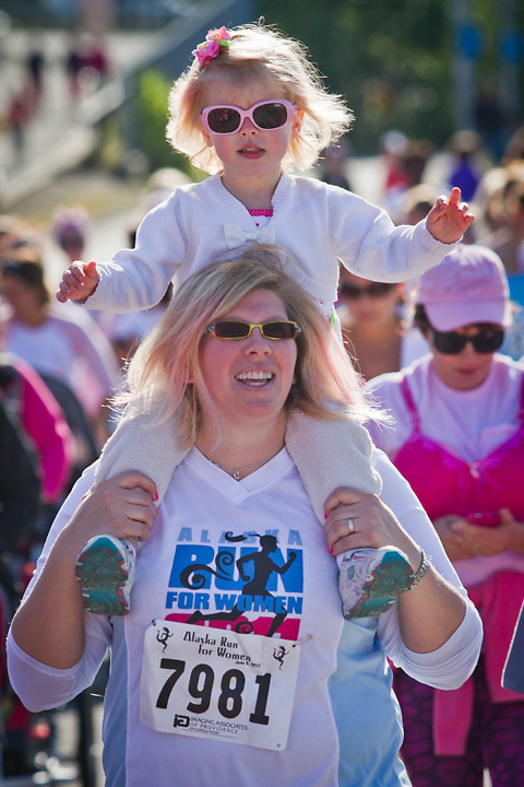 Two year old Reilly Cooper on the shoulders of her mother, Dana, at the Alaska Run for Women, Anchorage