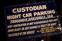 A signboard at the entrance of a Srinagar car parking bay, Kashmir, India..Pre-season Jeep road trip from Delhi to Amritsar, Srinagar, Kargil, Lamayuru, Leh, Khardung La, Tso Moriri and back to Delhi in May 2010. Photo by Suzanne Lee.