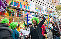 Retail workers and union supporters, some dressed as Oompa-Loompas channeling Charlie and the Chocolate Factory, protest in front of Dylan's Candy Bar in the Upper East Side neighborhood of New York on Wednesday, October 30, 2013.  The workers chose the Halloween holiday to demand a living wage and more hours of work. (© Richard B. Levine)