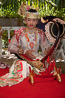 Myanmar, Burma. Bagan.  Traditional Burmese Musician Playing the Bent Harp (Saung Gauk).