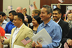 Braulio Ramon (right) becomes a United States citizen during a naturalization ceremony in federal court in Oxford, Miss. on Friday, June 29, 2012. Forty seven persons took the oath of citizenship.