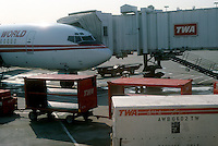 A TWA jet at the terminal in LaGuardia Airport in Queens in New York in September 1988. Piedmont is a subsidiary of US Airways. In 2001 the financially troubled airline was acquired by American Airlines flying its last flight under the Trans World Airlines brand on December 1, 2001. (© Richard B. Levine)