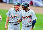 9 March 2010: Detroit Tigers' outfielder Austin Jackson (right) celebrates a run with Clete Thomas (left) during a Spring Training game against the Washington Nationals at Space Coast Stadium in Viera, Florida. The Tigers defeated the Nationals 9-4 in Grapefruit League action. Mandatory Credit: Ed Wolfstein Photo