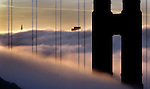 Just the tops of the tallest building of the San Francisco skyline was visual just before sunrise viewed from the Marin headlands looking through the south tower of the Golden Gate Bridge